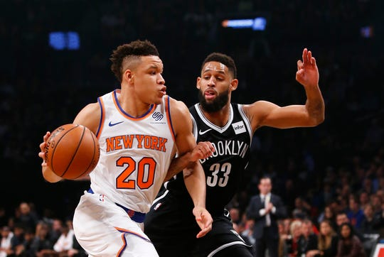 Oct 19, 2018; Brooklyn, NY, USA; New York Knicks forward Kevin Knox (20) drives to the basket against Brooklyn Nets guard Allen Crabbe (33) during the first half at Barclays Center.