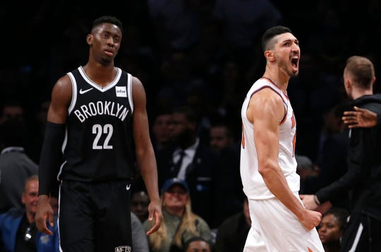 Oct 19, 2018; Brooklyn, NY, USA; New York Knicks center Enes Kanter (right) reacts after making a basket against Brooklyn Nets guard Caris LeVert (22) during the second half at Barclays Center.
