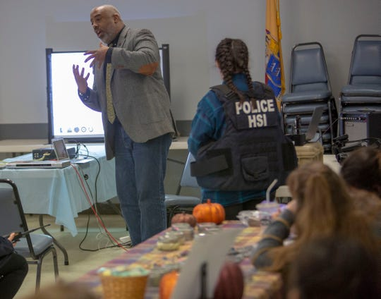 Kevin Tillman, a rescue operative in the child exploitation and human trafficking unit for Immigrations and Custom Enforcement (ICE )Homeland Security Investigations (HSI) addresses the audience during the human trafficking awareness event  at the Borough of Totowa Community Center on Saturday, October 20 2018. Grace Rose, A girl scout, organized the event as part of her Gold Award project.