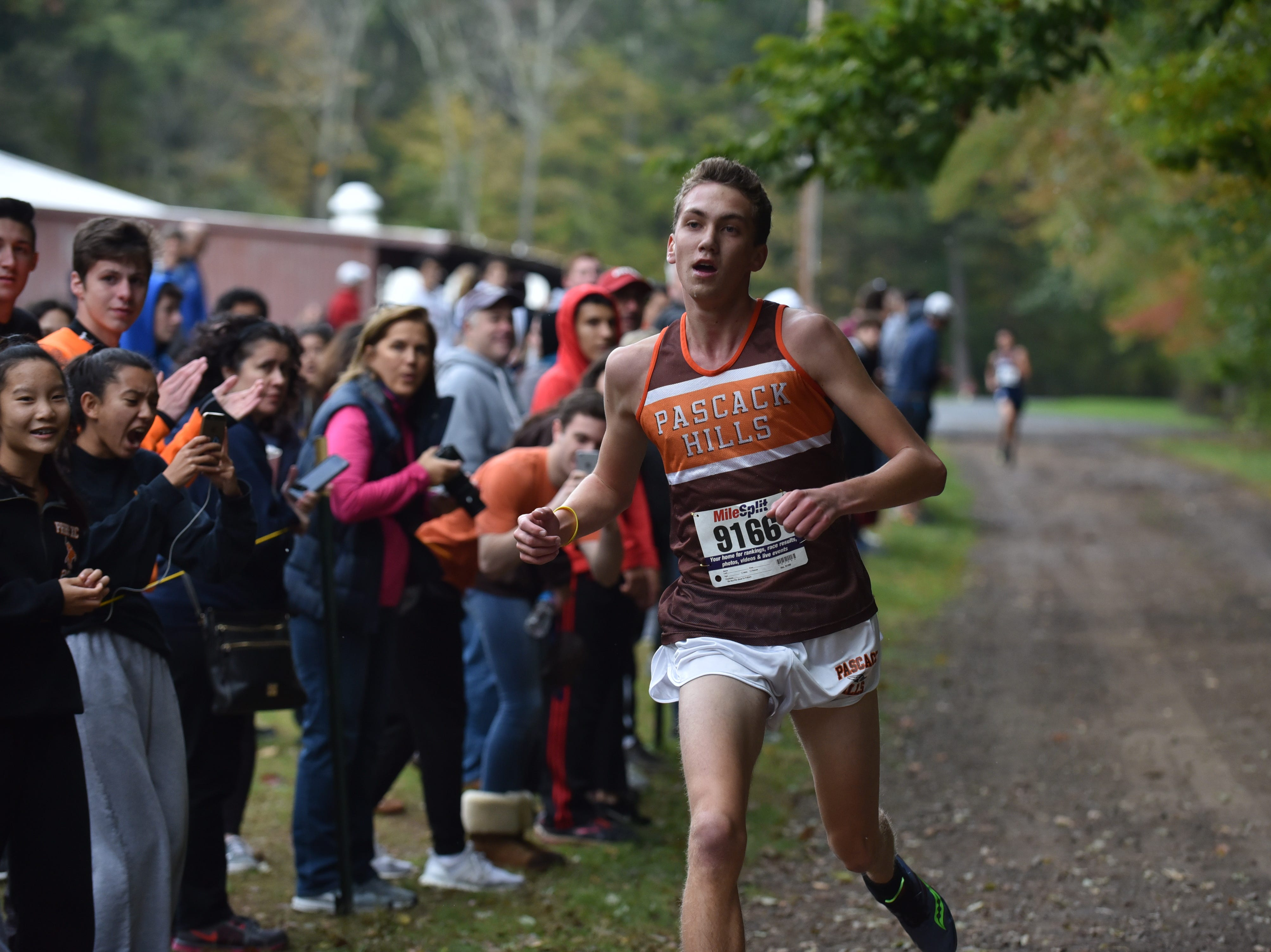 Dillon Jensen of Pascack Hills wins 1st in Group C at the Bergen County Cross Country Championships.