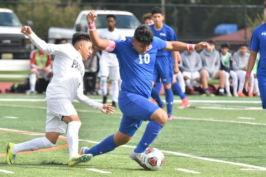 Passaic Tech's Axel Velazquez (10) takes control of the ball during a Passaic county boys soccer semifinal on Saturday, Oct. 20, 2018 against Passaic. Passaic Tech wins the game, 2-0, and advances to its first county championship game in 10 years.