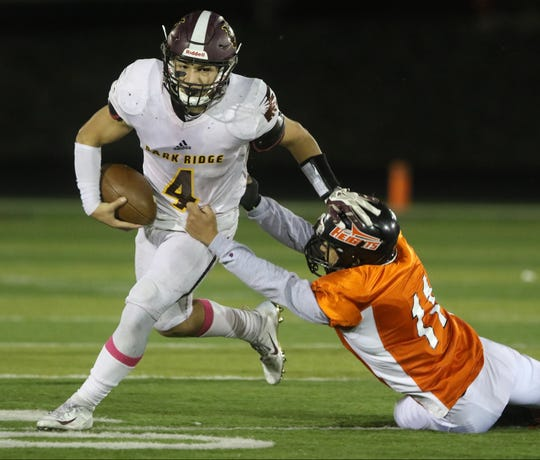 Vincent Pinto of Park Ridge breaks a tackle attempt by Etni Alvis of Hasbrouck Heights in the second half.