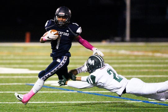 New Milford at Rutherford in North Jersey Interscholastic Conference playoff semifinal on Friday, October 19, 2018. R #1 Abellany Mendez avoids a tackle in the first quarter.