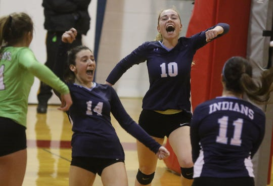 Alexandra Calello, Carly Birnberg, Gracie Watson and Amanda Galenkamp of Wayne Valley celebrate their Passaic County Tournament championship win after scoring the final point in the third set.