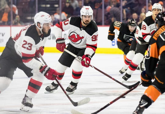 Oct 20, 2018; Philadelphia, PA, USA; New Jersey Devils left wing Marcus Johansson (90) brings the puck up ice against the Philadelphia Flyers during the first period at Wells Fargo Center.