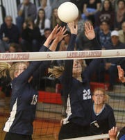 Molly McAtee and Julianna Lavner of Wayne valley hit the ball back to Passaic Tech.