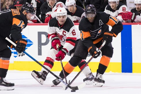 Oct 20, 2018; Philadelphia, PA, USA; Philadelphia Flyers right wing Wayne Simmonds (17) and center Sean Couturier (14) and New Jersey Devils defenseman Andy Greene (6) battle for the puck during the first period at Wells Fargo Center.
