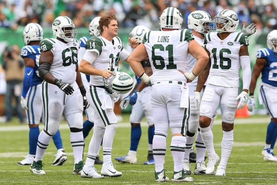 Oct 14, 2018; East Rutherford, NJ, USA; New York Jets quarterback Sam Darnold (14) talks with teammates during the second half against the Indianapolis Colts at MetLife Stadium.