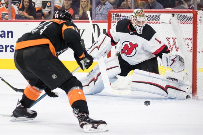 New Jersey Devils goaltender Keith Kinkaid (1) defends against Philadelphia Flyers center Sean Couturier (14) during the second period at Wells Fargo Center.