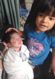 Lilliana with younger sister Karolynn, who weighed just 3 pounds, 15 ounces at birth.