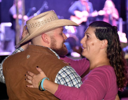Cody and Kymm Austin, from Albuquerque, dance to the music of Sugar & Steel at the Las Cruces Country Music Festival on Friday, Oct. 19, 2018.