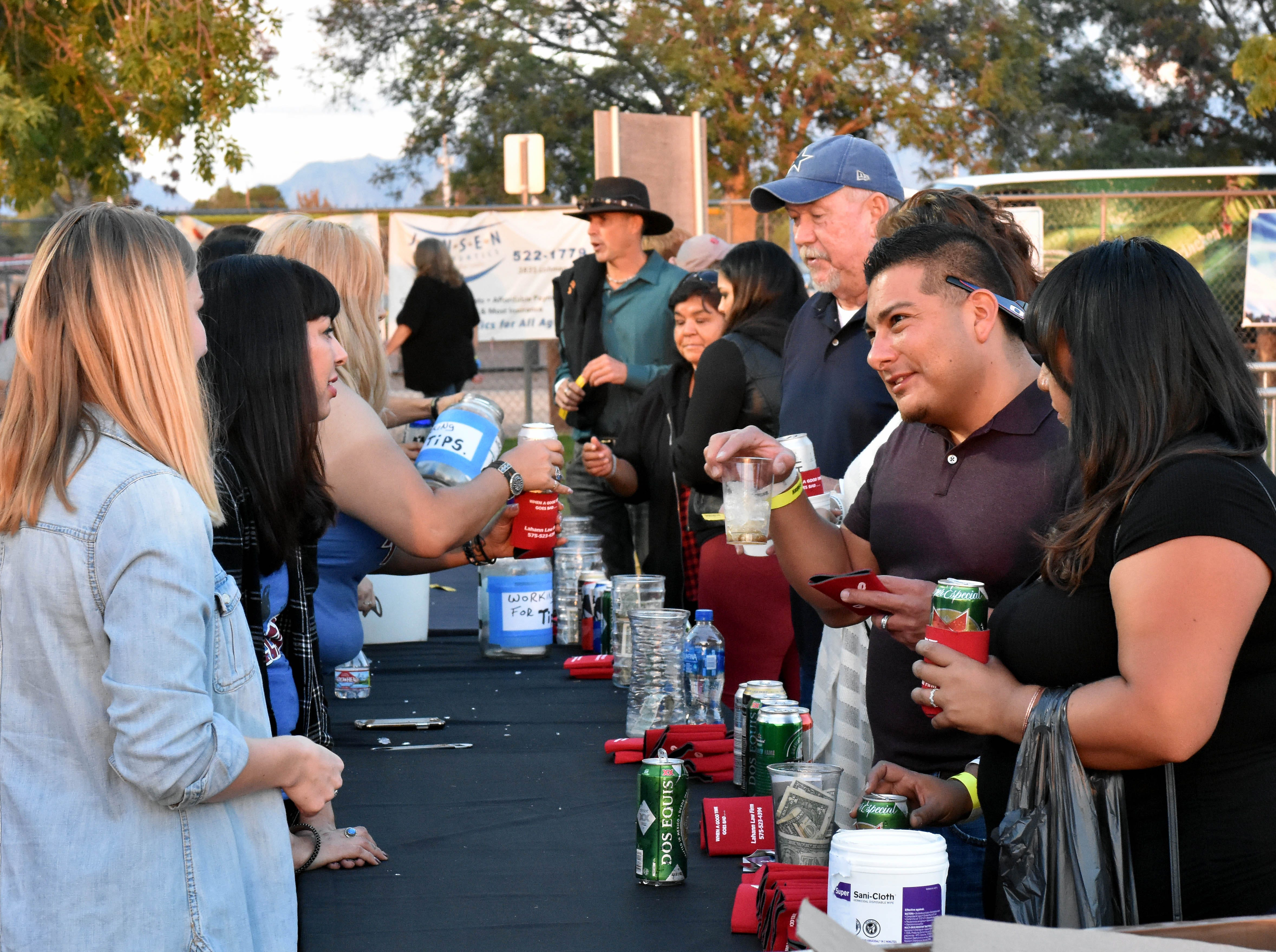 Lines start to form at the beverage area between acts at the Las Cruces Country Music Festival on Friday, Oct. 19, 2018.