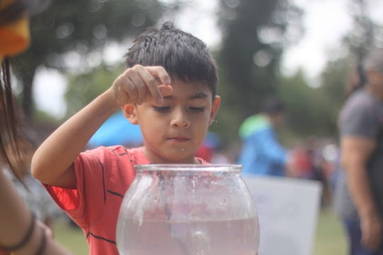 Local children enjoy Carnival games at the 10th annual Fallapalooza, Oct. 20 at Lake Carlsbad Beach Park.
