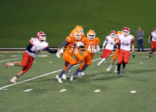 Artesia's Alex Harmon returns a kick during the first half of Friday's game.