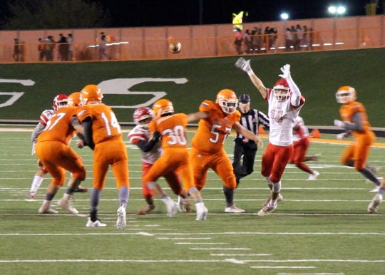 Artesia quarterback Trent Taylor throws a pass during the first half of Friday's game against Roswell.