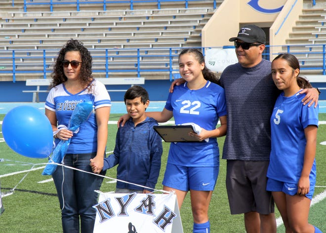 Senior Nyah Chacon (22) is honored on Senior Day before Saturday's match against Roswell. The Cavegirls won, 9-0.