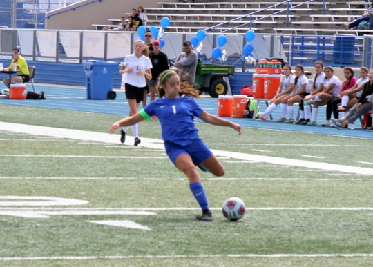 Gabby Aragon loads up for a first half shot during Saturday's match against Roswell. Aragon finished with two assists and the Cavegirls won, 9-0.
