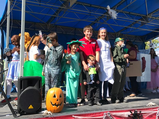 """The group of insurance company spokespeople, including Flo from Progressive, the general from 1-800-General, and """"Mayhem"""" from Allstate, won the """"Most Creative"""" family costume award at the 2018 Zoo Boo costume contest."""