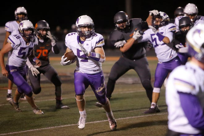 Kirtland Central's Cadan Flack (5) finds space after making a catch and takes off down the right side against Aztec during Friday's District 1-4A game at Fred Cook Stadium in Aztec.