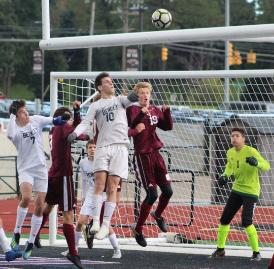 Berkley's Max Rebori (10) and Seaholm's Sam Sheckell (19) battle in the box during action in Saturday's Division 1 championship game played at Bloomfield Hills High School.