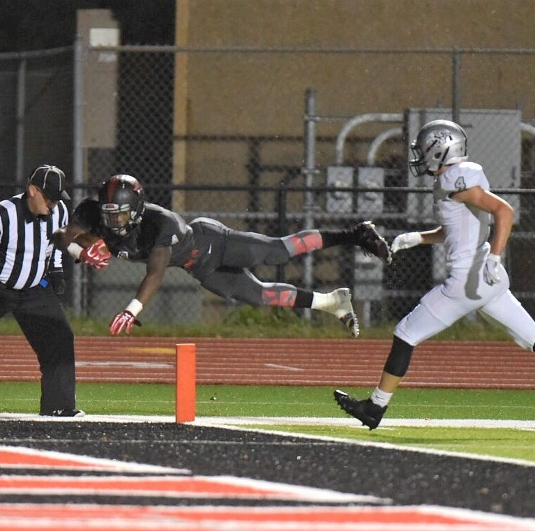 Churchill soars into postseason with 42-21 triumph over Plymouth
