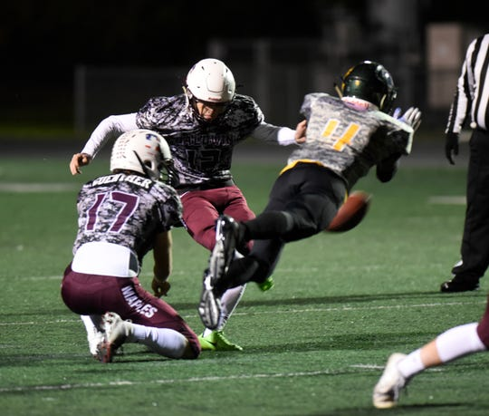 Seaholm kicks a field goal in the first quarter.