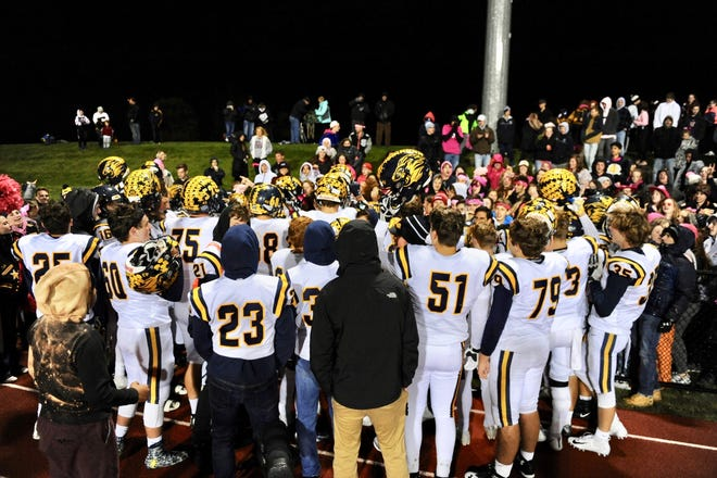 South Lyon players go up to the stands to greet fans after Friday's 20-15 win over South Lyon East.