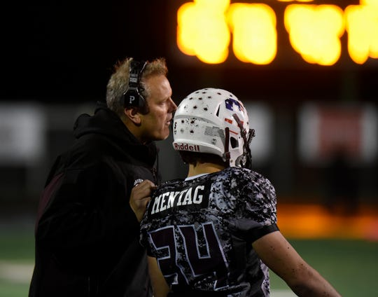 Seaholm coach Jim DeWald and running back Chase Mentag.