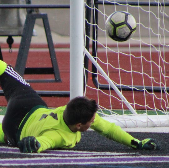 After making the initial save, Seaholm goalie Leo Adams can only watch helplessly as Berkley's eventual game-winning goal by Marco Luna-gen flips into the net during Saturday's Division 1 district championship game.