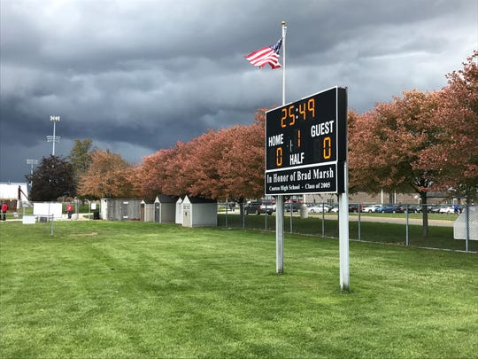 With dark clouds looming, Saturday's boys soccer district final between Canton and Salem was stopped and later postponed until Sunday.
