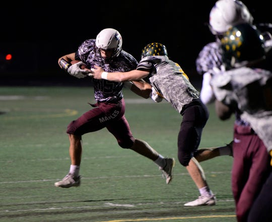 Birmingham Seaholm's Paul Jokisch carries the ball during Week 9 contest against crosstown rival Groveswon by the Falcons 26-9 Oct. 19, 2018.