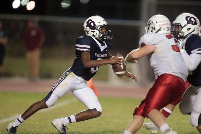 La Quinta quarterback Christian Egson in action against Palm Springs on Friday, October 19, 2018 in La Quinta.