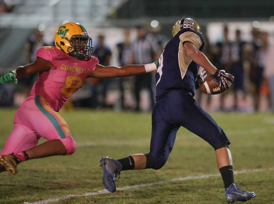 Josh Moore of Coachella Valley runs down  Desert Hot Springs quarterback Nathan Kelly, October 19, 2018.