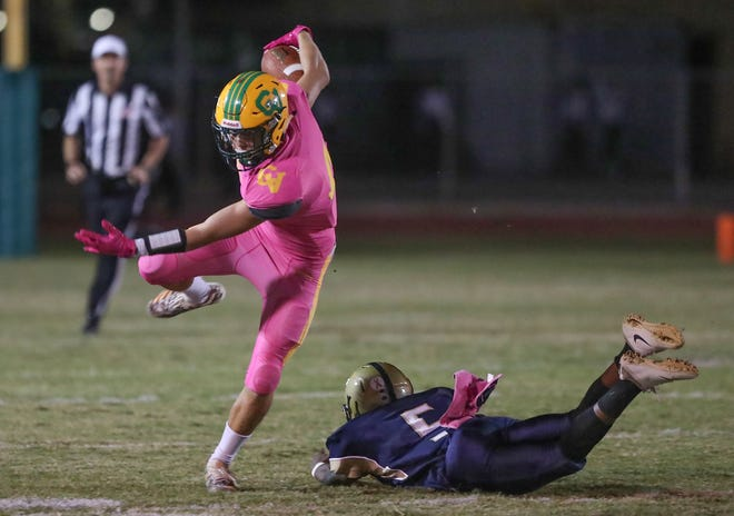Angelo Fitzgerald of Coachella Valley sidesteps a tackle against Desert Hot Springs, October 19, 2018.