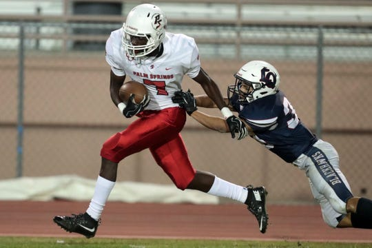 Palm Springs' Damien King catches a pass to him in the first quarter against La Quinta on Friday, October 19, 2018 in La Quinta.