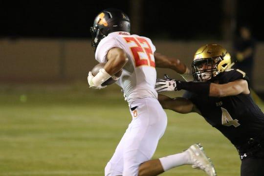 Palm Desert's Jordan Garcia races around the end against Xavier Prep  on Friday, October 19, 2018. Garcia ran for four touchdowns.