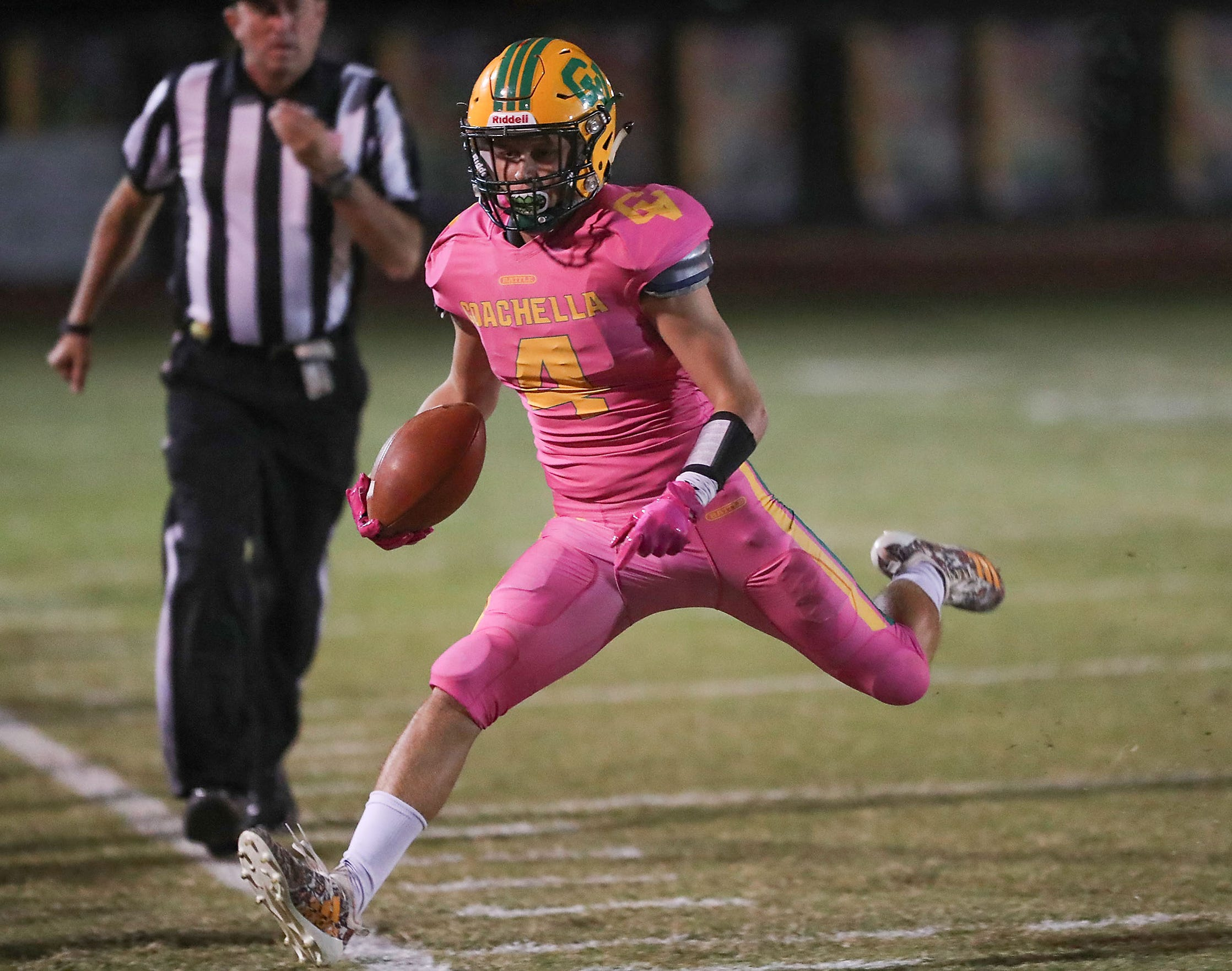Angelo Fitzgerald of Coachella Valley runs for a first down against Desert Hot Springs, October 19, 2018.