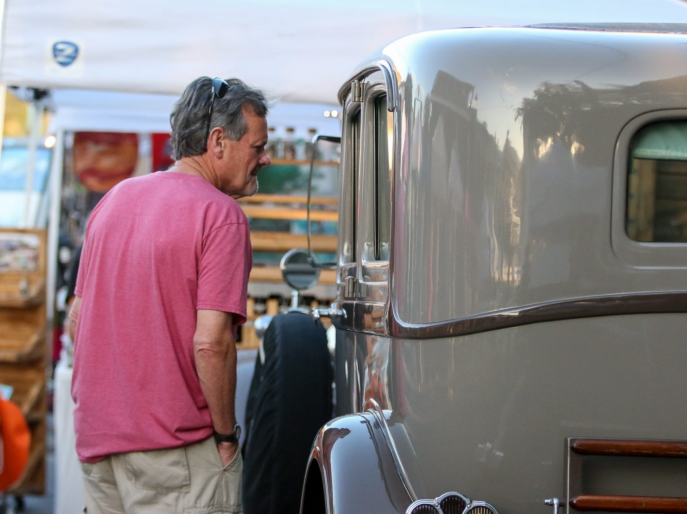 Bill Fennessey, of Superior, Wis., checks out the 1930 Packard in front of The District during Gallery Night on Friday, October 19, 2018.