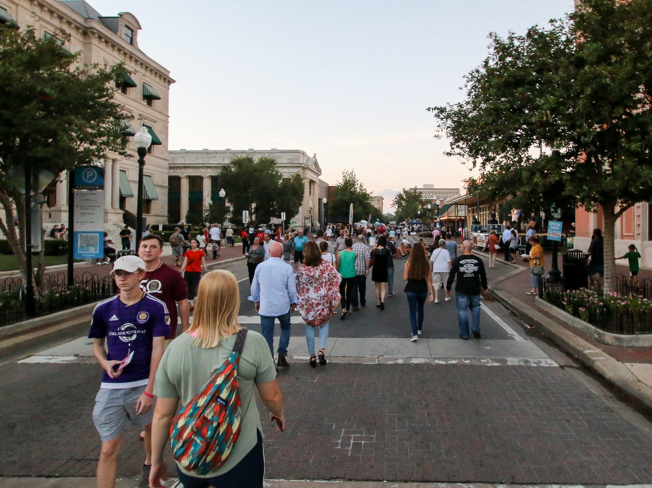 People make their way down Palafox Place during Gallery Night on Friday, October 19, 2018.