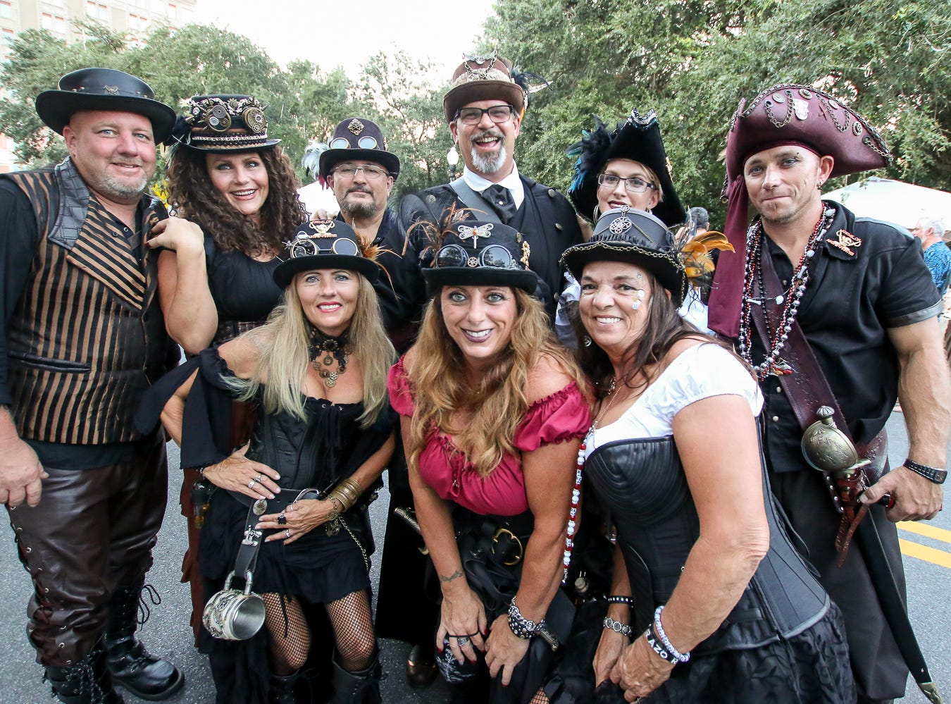 Members of the Krewe of Airship Pirates pose for a quick picture during Gallery Night on Friday, October 19, 2018.