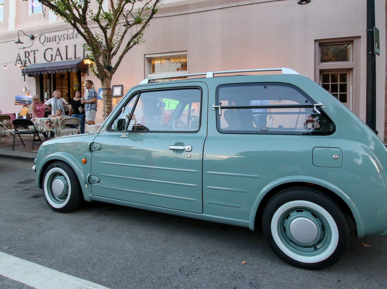 A 1989 Nissan Pao is parked on display in front of Quayside Art Gallery during Gallery Night on Friday, October 19, 2018.