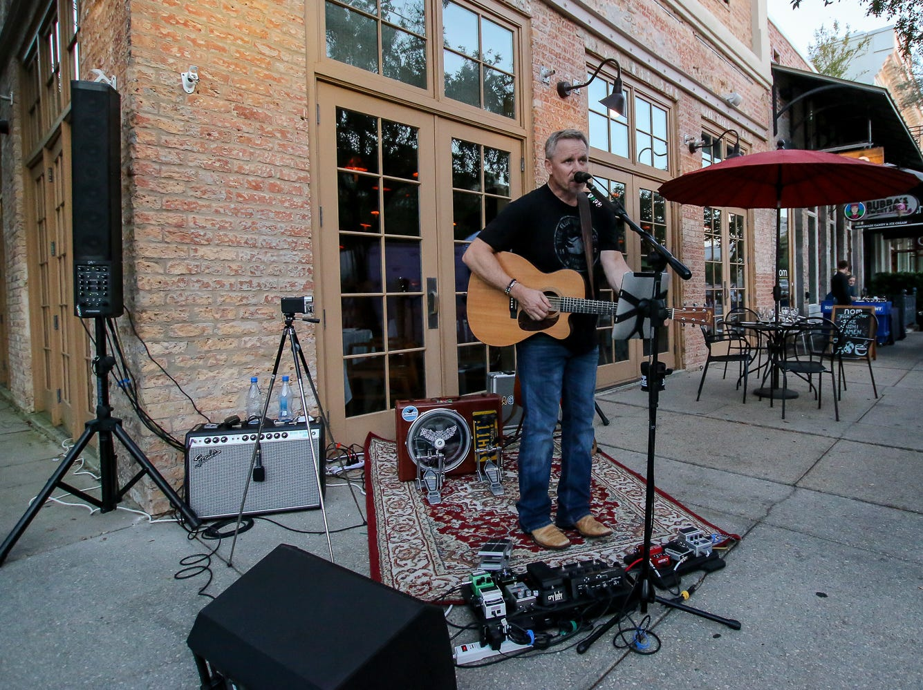Colt Weston performs in front of Jackson's Steakhouse during Gallery Night on Friday, October 19, 2018.