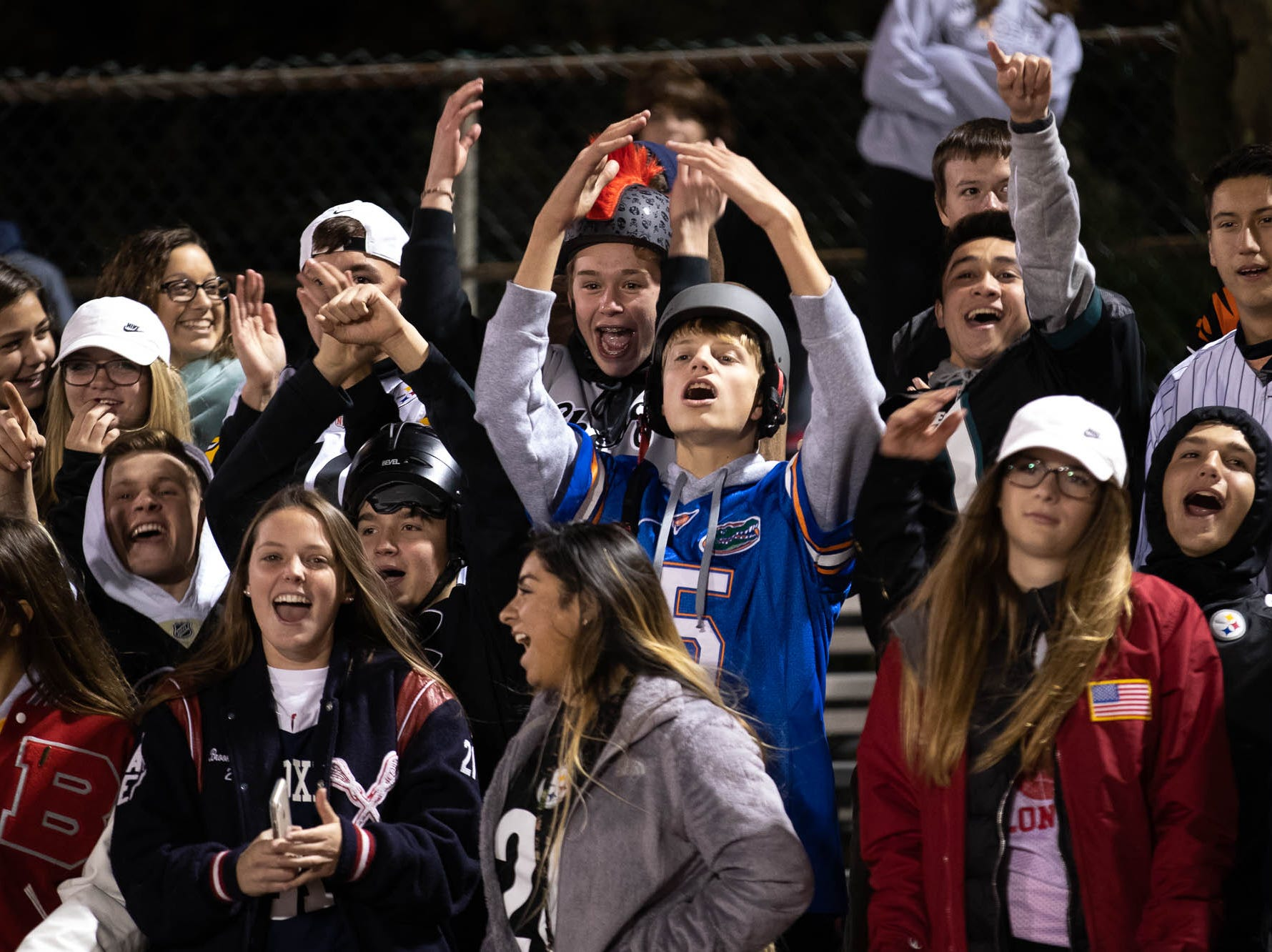 The New Oxford student section cheers during the second half of a football game between South Western and New Oxford, Friday, Oct. 19, 2018, in Penn Township. The New Oxford Colonials beat the South Western Mustangs 21-14.