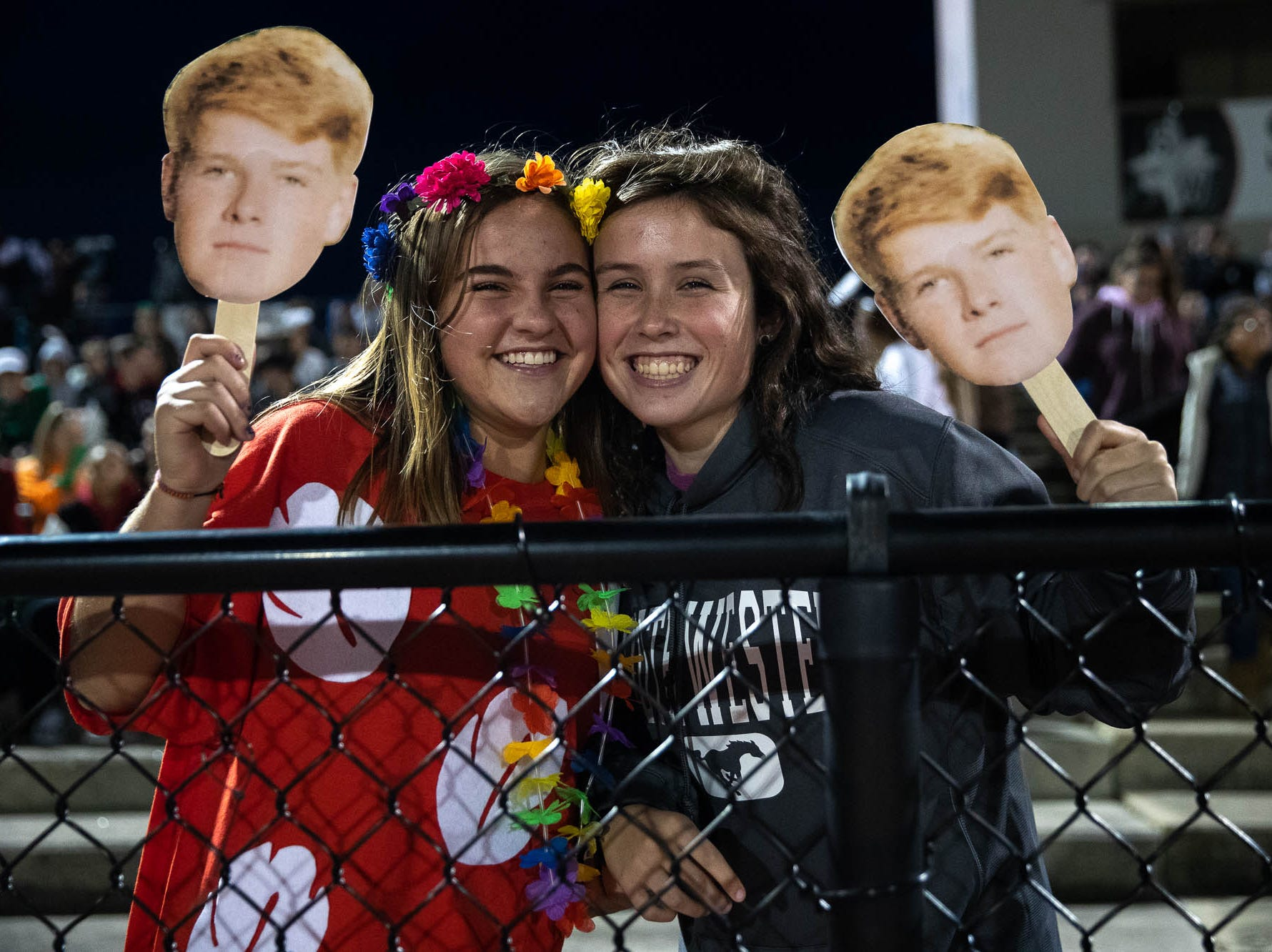 Two members of the South Western student section pose for a photo during a football game between South Western and New Oxford, Friday, Oct. 19, 2018, in Penn Township.