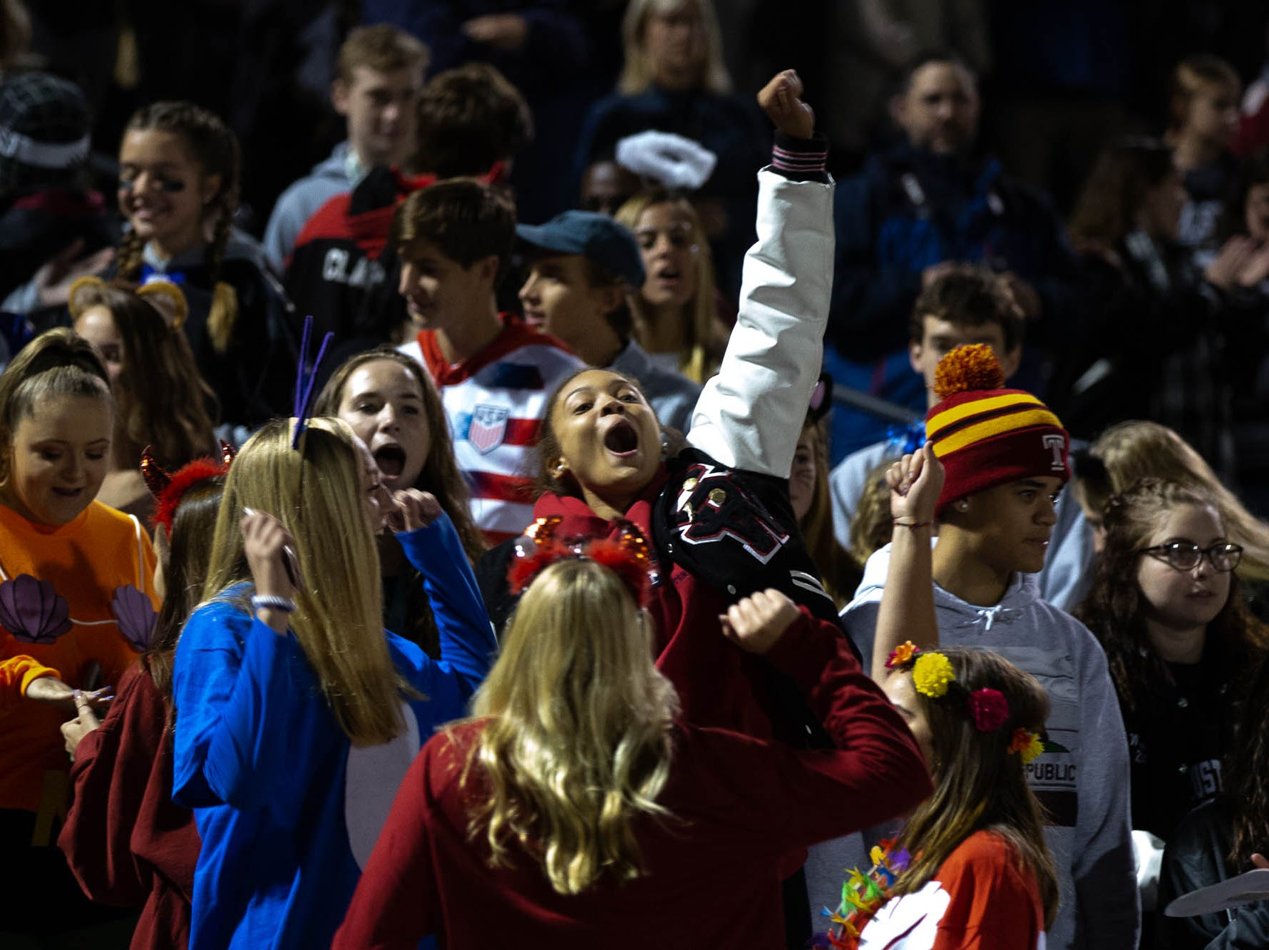 The South Western student section cheers during a football game between South Western and New Oxford, Friday, Oct. 19, 2018, in Penn Township.