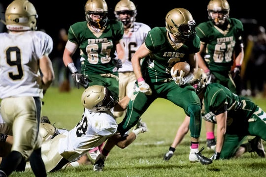 York Catholic's Cole Witman slips a tackle from Delone Catholic's Joe Hernandez while carrying the ball on Friday, October 19, 2018. The Squires fell 35-7.