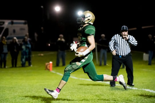 York Catholic's Cole Witman trots into the end zone to score a touchdown against Delone Catholic on Friday, October 19, 2018. The Fighting Irish won 35-7.
