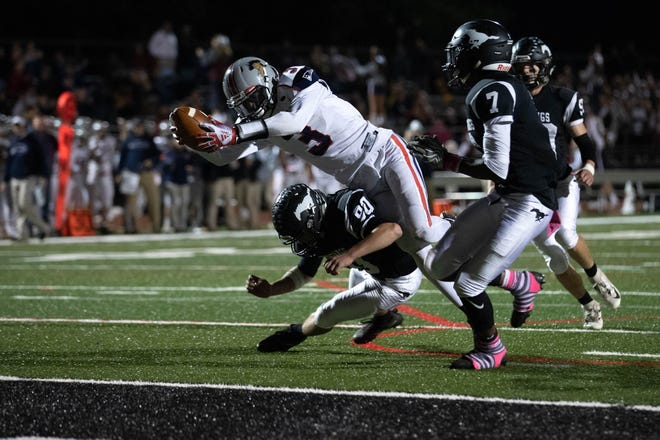 New Oxford's Abdul Janneh (3) dives into the end zone for a touchdown during a football game between South Western and New Oxford, Friday, Oct. 19, 2018, in Penn Township.