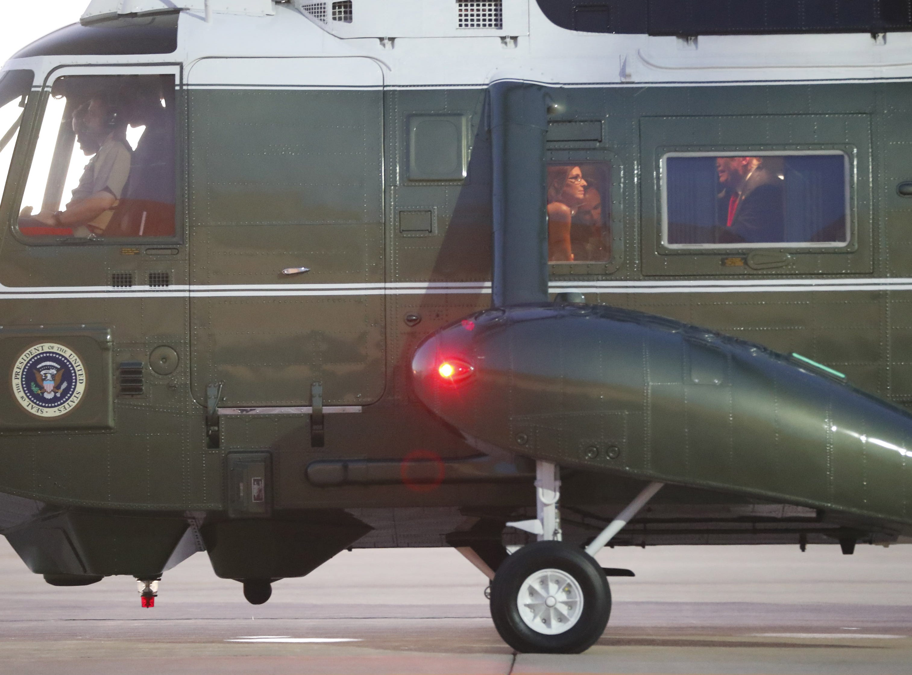 Rep. Martha McSally talks with President Donald Trump on Marine One after a defense capability tour at Luke Air Force Base in Glendale, on Oct. 19, 2018.