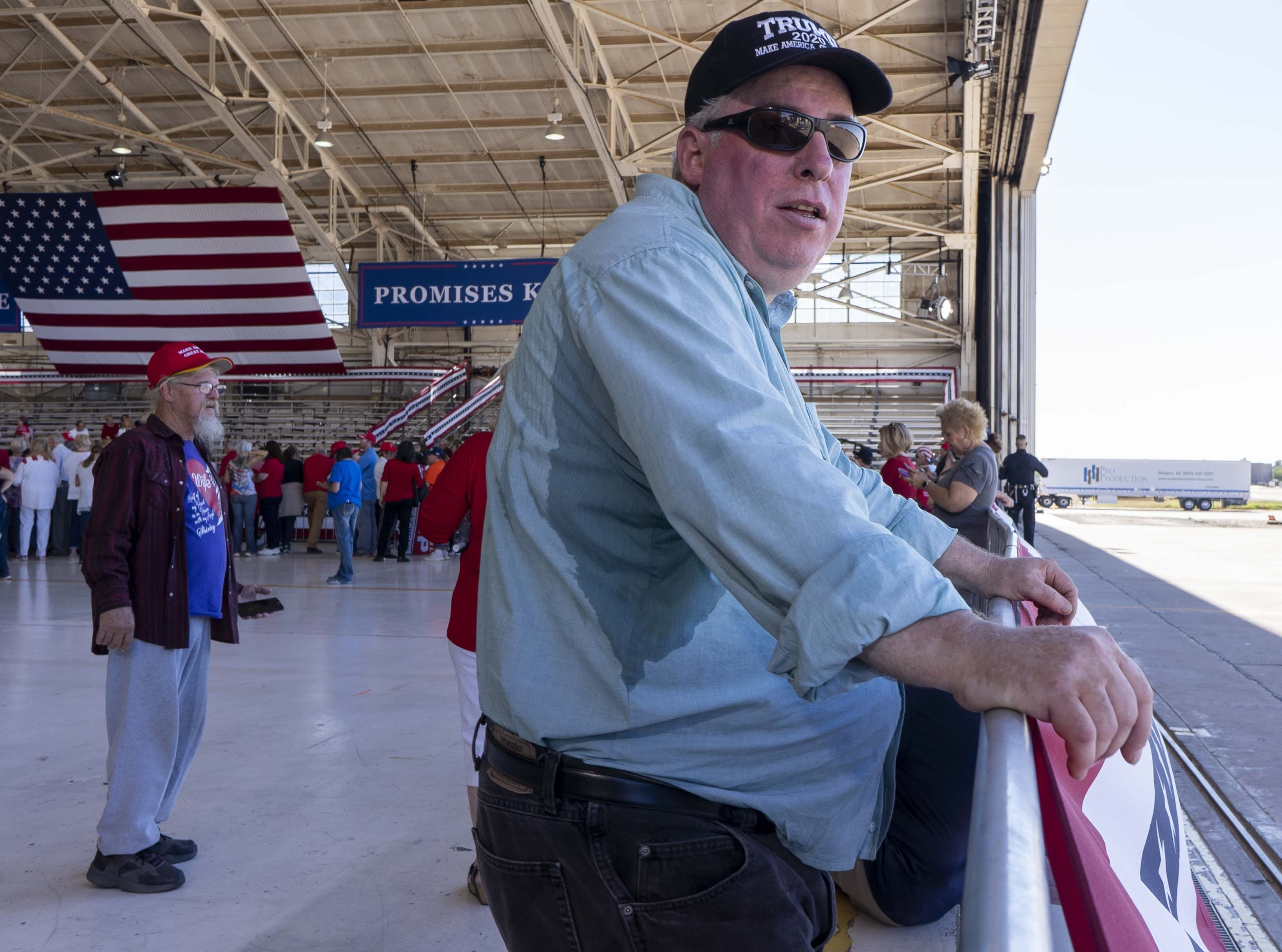 Supporters of President Donald Trump wait for the president's rally supporting Martha McSally at Phoenix-Mesa Gateway Airport on Oct. 19, 2018.